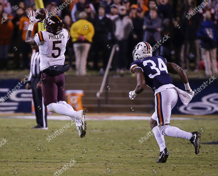 Virginia Tech Hokies WR #5 Cam Phillips makes a catch in front of University of Virginia Cavalier CB #34 Bryce Hall during NCAA football game between the University of Virginia Cavaliers and the Virginia Tech Hokies at Scott Stadium in Charlottesville, Virginia