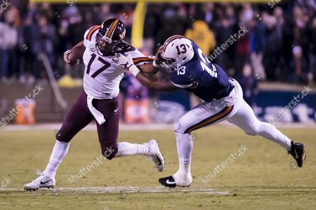 Virginia Tech Hokies quarterback Josh Jackson (17) tries to get away from the grasp of Virginia Cavaliers linebacker Chris Peace (13) during the NCAA football game between the Virginia Tech Hokies and the Virginia Cavaliers at David A. Harrison III Field at Scott Stadium in Charlottesville, Virginia