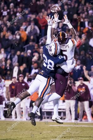 Virginia Tech Hokies wide receiver Cam Phillips (5) and Virginia Cavaliers safety Brenton Nelson (28) vie for the ball during the NCAA football game between the Virginia Tech Hokies and the Virginia Cavaliers at David A. Harrison III Field at Scott Stadium in Charlottesville, Virginia