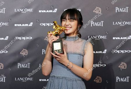 """Stock Image of Taiwanese actress Vicky Chen holds her award and poses for media for Best Supporting Actress at the 54th Golden Horse Awards in Taipei, Taiwan, . Chen won for the film """"The Bold, The Corrupt, and The Beautiful"""" at this year's Golden Horse Awards -the Chinese-language film industry's biggest annual events"""