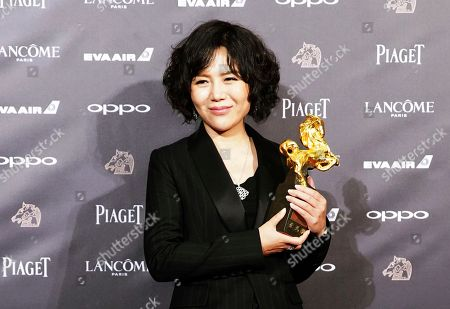 """Chinese director Vivian Qu holds her awards and poses for media for Best The Best Director at the 54th Golden Horse Awards in Taipei, Taiwan, . Qu won for the film """"Angels Wear White"""" at this year's Golden Horse Awards -the Chinese-language film industry's biggest annual events"""