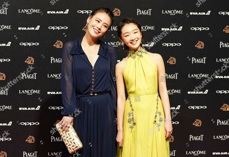 Zhou Dongyu, Sandra Ma. Chinese actress Sandra Ma, left, and Zhou Dongyu poses on the red carpet at the 54th Golden Horse Awards in Taipei, Taiwan, . Zhou is the guest at this year's Golden Horse Awards, one of the Chinese-language film industry's biggest annual events