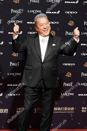Hong Kong actor Eric Tsang poses on the red carpet at the 54th Golden Horse Awards in Taipei, Taiwan, . Tsang is the guest at this year's Golden Horse Awards, one of the Chinese-language film industry's biggest annual events