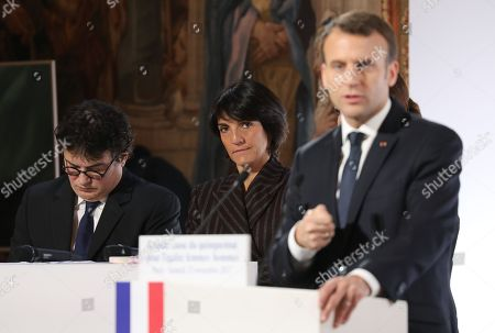 Stock Picture of French President Emmanuel Macron (R) stands next to French humorist and patron of association 'Women Safe' Florence Foresti and French writer, activist and specialist of emergency medical services Patrick Pelloux (L) as he delivers a speech during the International Day for the Elimination of Violence Against Women, at the Elysee Palace in Paris, France, 25 November 2017. The United Nations General Assembly has designated November 25 as the International Day for the Elimination of Violence Against Women in an effort to raise awareness of the fact that women around the world are subject to rape, domestic violence and other forms of violence.