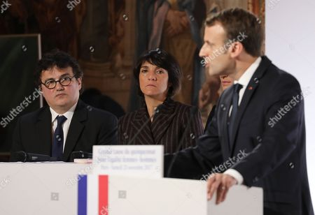 Stock Photo of French President Emmanuel Macron (R) stands next to French humorist and patron of association 'Women Safe' Florence Foresti and French writer, activist and specialist of emergency medical services Patrick Pelloux (L) as he delivers a speech during the International Day for the Elimination of Violence Against Women, at the Elysee Palace in Paris, France, 25 November 2017. The United Nations General Assembly has designated November 25 as the International Day for the Elimination of Violence Against Women in an effort to raise awareness of the fact that women around the world are subject to rape, domestic violence and other forms of violence.