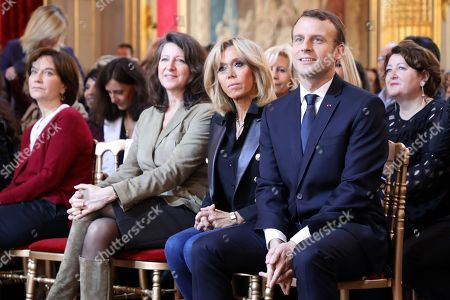 French President Emmanuel Macron (R) together with his wife Brigitte Macron (2-R), French Minister for Solidarity and Health Agnes Buzyn (2-L) and French senator Laurence Rossignol listen as the French Junior Minister for Gender Equality addresses guests at the International Day for the Elimination of Violence Against Women, at the Elysee Palace in Paris, France, 25 November 2017. The United Nations General Assembly has designated November 25 as the International Day for the Elimination of Violence Against Women in an effort to raise awareness of the fact that women around the world are subject to rape, domestic violence and other forms of violence.
