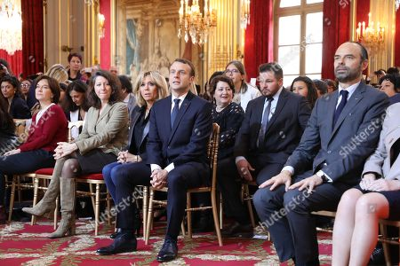 Stock Picture of French President Emmanuel Macron (front row, 2-R) together with his wife Brigitte Macron (3-R), French Minister for Solidarity and Health Agnes Buzyn (2-L), French senator Laurence Rossignol (L) and French Prime Minister Edouard Philippe listen as the French Junior Minister for Gender Equality addresses guests at the International Day for the Elimination of Violence Against Women, at the Elysee Palace in Paris, France, 25 November 2017. The United Nations General Assembly has designated November 25 as the International Day for the Elimination of Violence Against Women in an effort to raise awareness of the fact that women around the world are subject to rape, domestic violence and other forms of violence.