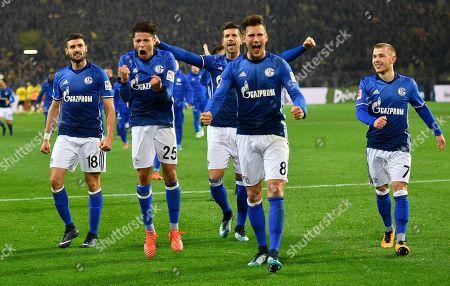 From left, Schalke's Daniel Caligiuri, Amine Harit, Matija Nastasic, Leon Goretzka and Max Meyer celebrate after the German Bundesliga soccer match between Borussia Dortmund and FC Schalke 04 in Dortmund, Germany, . The match ended in a 4-4 draw