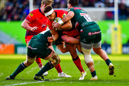 Jackson Willison of Worcester Warriors is tackled by Gareth Owen of Leicester Tigers