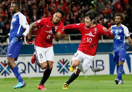 Urawa Reds' Rafael da Silva, 8, celebrates with teammate Yosuke Kashiwagi after scoring a goal against Al Hilal of Saudi Arabia during the second leg of their AFC Champions League final soccer match in Saitama, north of Tokyo