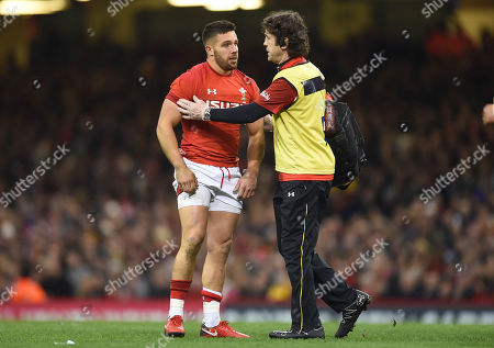 Stock Picture of Rhys Webb of Wales leave the field with Physio Mark Davies.