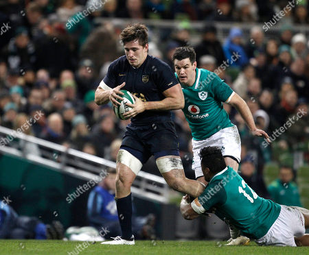 Argentina's Santiago Gonzalez Iglesias, left, is tackled by Ireland's Bundee Aki, right, during a rugby union international match at the Aviva stadium in Dublin, Ireland