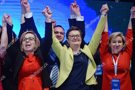 Stock Image of Newly choosen leader of the Nowoczesna (Modern) party Katarzyna Lubnauer, center, celebrates delegates at the party's congress in Warsaw, Poland, . In a close vote Saturday, the party's national convention chose prominent member Katarzyna Lubnauer to replace economist Ryszard Petru, who founded the party before the 2015 election in which it won 28 seats in the 460-member parliament