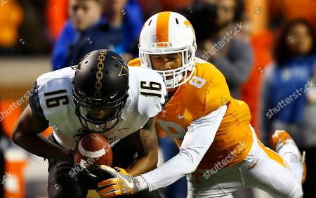 Kalija Lipscomb, Justin Martin. Vanderbilt wide receiver Kalija Lipscomb (16) makes a catch as he's defended by Tennessee defensive back Justin Martin (8) in the first half of an NCAA college football game, in Knoxville, Tenn