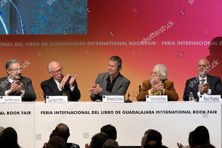 French writer Emmanuel Carrere (C), winner of the FIL Award of Romance Languages, Federal Secretary of Health Jose Narro (2L), Mexican writer Fernando del Paso (R), President of the Supreme Court of Justice Luis Maria Aguilar (L) and FIL's President Raul Padilla (R) paricipate at the opening of the International Book Fair (FIL) of Guadalajara, Jalisco, Mexico, 25 November 2017. The 31st edition of the FIL has Madrid as guest of honor.