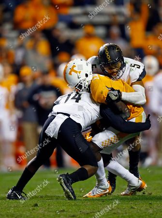 Brandon Johnson, Ryan White, LaDarius Wiley. Tennessee wide receiver Brandon Johnson (7) is tackled by Vanderbilt safety Ryan White (14) and safety LaDarius Wiley (5) in the second half of an NCAA college football game, in Knoxville, Tenn