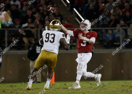 K.J. Costello, Jay Hayes. Stanford quarterback K.J. Costello (3) throws a pass under pressure from Notre Dame defensive lineman Jay Hayes (93) during the first half of an NCAA college football game, in Stanford, Calif
