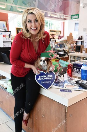 Wendy Burch shops small during the 8th Annual Small Business Saturday, founded by American Express, at Healthy Spot on in West Hollywood, Calif