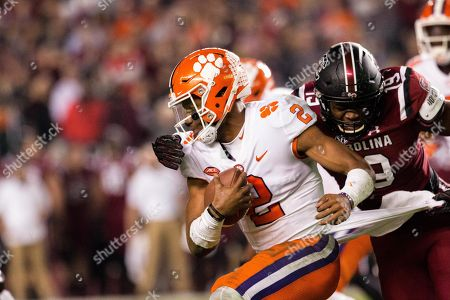 Clemson quarterback Kelly Bryant (2) gets caught by South Carolina defensive lineman Brad Johnson (19) in the NCAA football matchup between Clemson and South Carolina at Williams-Brice Stadium in Columbia, SC