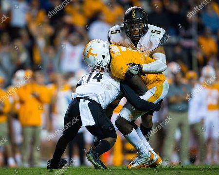 wide receiver Brandon Johnson #7 of the Tennessee Volunteers catches a pass and is tackled by safety Ryan White #14 and safety LaDarius Wiley #5 of the Vanderbilt Commodores during the NCAA Football game between the University of Tennessee Volunteers and the Vanderbilt University Commodores at Neyland Stadium in Knoxville, TN Tim Gangloff/CSM