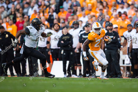 Stock Image of running back Carlin Fils-aime #27 of the Tennessee Volunteers runs the ball while linebacker Charles Wright #11 of the Vanderbilt Commodores pursues him during the NCAA Football game between the University of Tennessee Volunteers and the Vanderbilt University Commodores at Neyland Stadium in Knoxville, TN Tim Gangloff/CSM