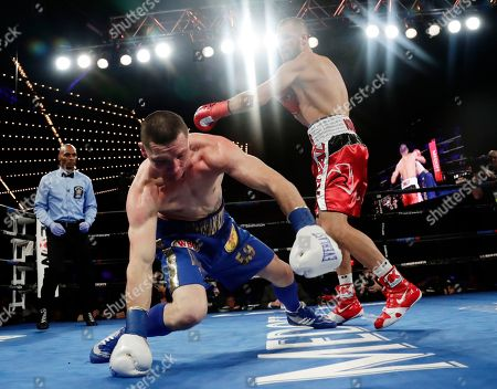Sergey Kovalev, Vyacheslav Shabranskyy. Russia's Sergey Kovalev knocks down Ukraine's Vyacheslav Shabranskyy during the first round of a light heavyweight title boxing match early, in New York. Kovalev stopped Shabranskyy in the second round