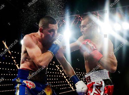 Sergey Kovalev, Vyacheslav Shabranskyy. Russia's Sergey Kovalev, right, punches Ukraine's Vyacheslav Shabranskyy during the second round of a light heavyweight title boxing match early, in New York. Kovalev stopped Shabranskyy in the second round