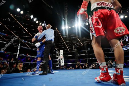 Sergey Kovalev, Vyacheslav Shabranskyy. The referee grabs Ukraine's Vyacheslav Shabranskyy to stop the fight during the second round of Shabranskyy's light heavyweight title boxing match against Russia's Sergey Kovalev, right, early, in New York. Kovalev stopped Shabranskyy in the second round