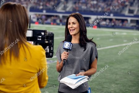 CBS reporter Tracy Wolfson reports from the sideline during an NFL football game between the Los Angeles Chargers and Dallas Cowboys, in Arlington, Texas