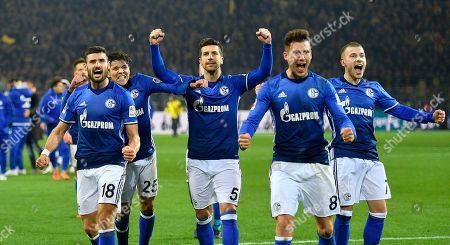 Schalke's Daniel Caligiuri, Amine Harit, Matija Nastasic, Leon Goretzka and Max Meyer, from left, celebrate after the German Bundesliga soccer match between Borussia Dortmund and FC Schalke 04 in Dortmund, Germany, . The match ended in a dramatic 4-4 after Dortmund led 4-0 at halftime