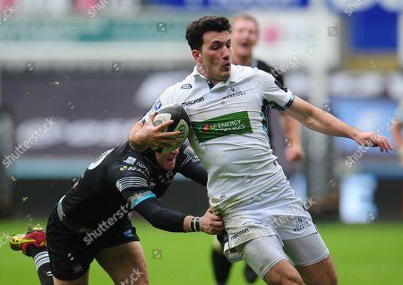 Ospreys vs Glasgow Warriors. Glasgow Warriors' Leonardo Sarto is tackled by Ospreys' Sam Davies