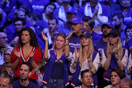 France's player Jo-Wilfried Tsonga's wife Noura El Shwekh (L), Julia Lang (2-L), wife of France's player Pierre-Hugues Herbert, Clemence Bertrand (2-R), wife of France's player Lucas Pouille and Oxana Pioline, wife of France's vice coach Cedric Pioline cheer during the single match of the Davis Cup Final between France and Belgium at the Pierre Mauroy Stadium in Villeneuve-d'Ascq, France, 26 November 2017.