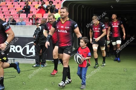 Southern Kings vs Scarlets. Southern Kings' Schalk Ferreira makes his way onto the pitch with the team mascot