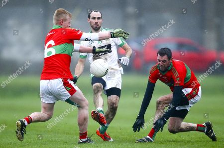 Stock Photo of Rathnew vs Moorefield. Moorefield's Kevin Murnaghan in action against Rathnew's John Manley and Damien Power