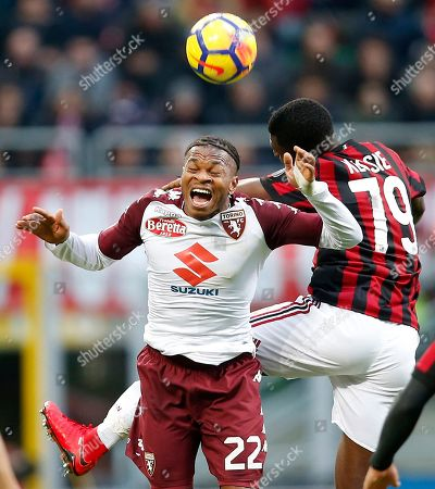 Torino's Joel Obi, left, jumps for the ball with AC Milan's Franck Kessie during their Serie A soccer match, at the San Siro stadium in Milan, Italy