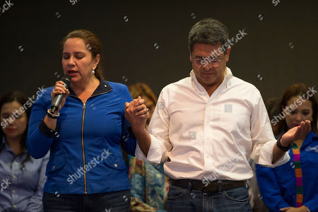 Juan Orlando Hernandez, Ana Garcia. Honduran President Juan Orlando Hernandez prays his wife Ana Garcia during an election night rally, in Tegucigalpa, Honduras, . (AP Photo/Moises Castillo)Hernandez, a conservative U.S. ally, appeared likely to win a second term despite opposition claims that his re-election is an unconstitutional power grab