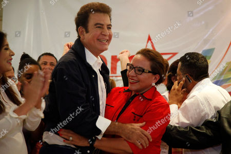 Salvador Nasralla, Xiomara Castro. Opposition Alliance presidential candidate Salvador Nasralla embraces former first lady and presidential candidate Xiomara Castro during a meeting with supporters in Tegucigalpa, Honduras, . Honduran President Juan Orlando Hernandez, a conservative U.S. ally, appeared likely to win a second term despite opposition claims that his re-election is an unconstitutional power grab