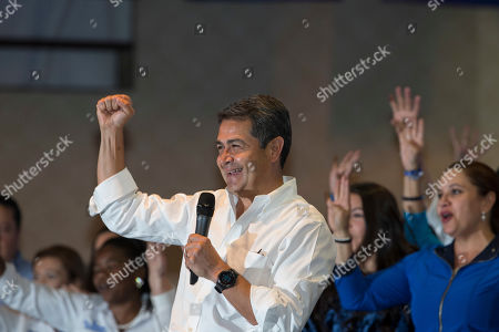 Honduran President Juan Orlando Hernandez delivers his speech during a meeting with supporters during election night, in Tegucigalpa, Honduras, . Hernandez, a conservative U.S. ally, appeared likely to win a second term despite opposition claims that his re-election is an unconstitutional power grab