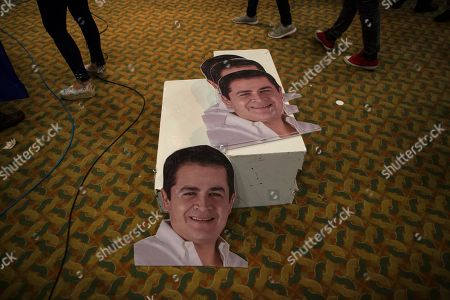 Stock Image of Election propaganda portraits of Honduran President Juan Orlando Hernandez lay on the floor after an election night meeting with supporters, in Tegucigalpa, Honduras, . Hernandez, a conservative U.S. ally, appeared likely to win a second term despite opposition claims that his re-election is an unconstitutional power grab