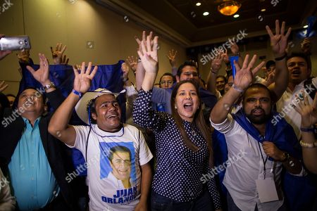 Supporters of Honduran President Juan Orlando Hernandez make the sign of four more years during a rally with supporters on election night, in Tegucigalpa, Honduras, . Hernandez, a conservative U.S. ally, appeared likely to win a second term despite opposition claims that his re-election is an unconstitutional power grab