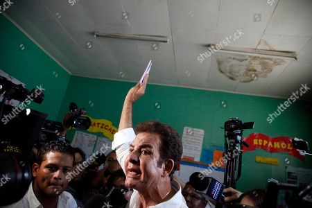 Opposition Alliance presidential candidate Salvador Nasralla greets supporters while casting his vote during the general elections in Tegucigalpa, Honduras, . Honduran President Juan Orlando Hernandez, a conservative U.S. ally, tries to win a second term despite opposition claims that his re-election is an unconstitutional power grab
