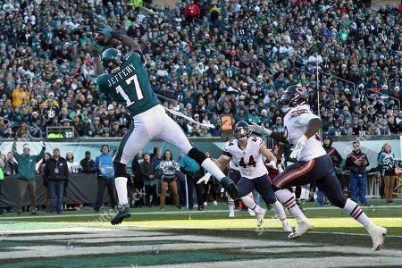 Alshon Jeffery, Christian Jones. Philadelphia Eagles' Alshon Jeffery (17) catches a touchdown pass against Chicago Bears' Christian Jones (52) during the first half of an NFL football game, in Philadelphia