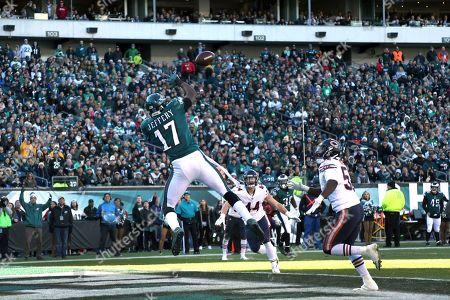 Stock Image of Alshon Jeffery, Christian Jones. Philadelphia Eagles' Alshon Jeffery (17) catches a touchdown pass against Chicago Bears' Christian Jones (52) during the first half of an NFL football game, in Philadelphia