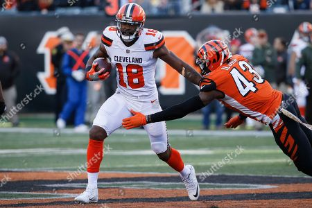 Kenny Britt, George Iloka. Cleveland Browns wide receiver Kenny Britt (18) runs the ball against Cincinnati Bengals free safety George Iloka (43) in the second half of an NFL football game, in Cincinnati