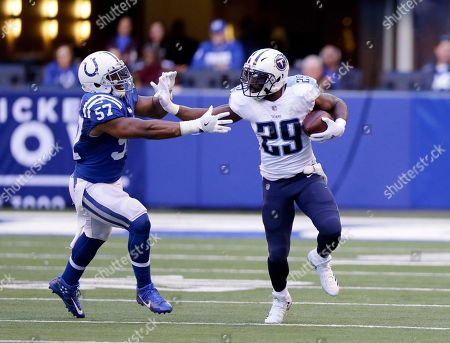 Tennessee Titans' DeMarco Murray (29) runs against Indianapolis Colts' Jon Bostic (57) during the second half of an NFL football game, in Indianapolis. Tennessee won 20-16