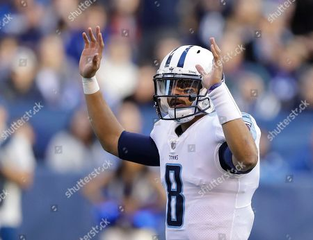 Tennessee Titans quarterback Marcus Mariota (8) reacts after a 1-yard touchdown run by running back DeMarco Murray during the second half of an NFL football game against the Indianapolis Colts, in Indianapolis