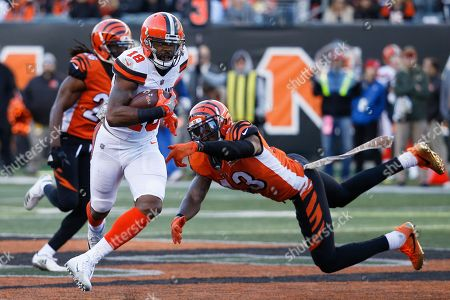 Kenny Britt, George Iloka. Cleveland Browns wide receiver Kenny Britt (18) shakes off Cincinnati Bengals free safety George Iloka (43) in the second half of an NFL football game, in Cincinnati
