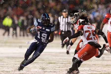 Toronto Argonauts S.J. Green (19) carries the ball while Calgary Stampeders Jamar Wall (29) defends during the CFL Grey Cup Championship game between Calgary Stampeders and Toronto Argonauts at TD Place Stadium in Ottawa, Canada. Toronto Argonauts won the Grey Cup by a score of 27-24
