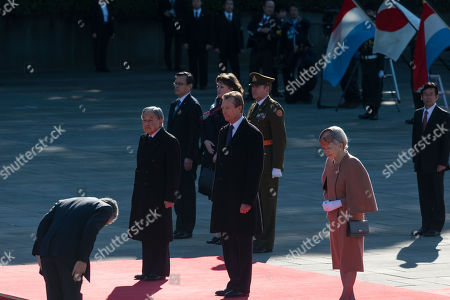 Grand Duke Henri of Luxembourg (C) listens to national anthems with Japanese Emperor Akihito (L) and Empress Michiko (R) during the welcoming ceremony at the Imperial Palace in Tokyo, Japan, 27 November 2017. Grand Duke Henri and Princess Alexandra of Luxembourg are on a four-day visit to Japan.