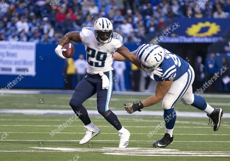 Tennessee running back DeMarco Murray (29) runs with the ball as Indianapolis Colts defensive lineman Al Woods (99) pursues during NFL football game action between the Tennessee Titans and the Indianapolis Colts at Lucas Oil Stadium in Indianapolis, Indiana. Tennessee defeated Indianapolis 20-16
